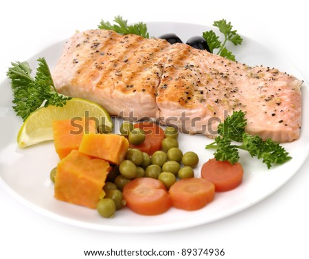 Grilled Salmon Fillet With Vegetables On White Background