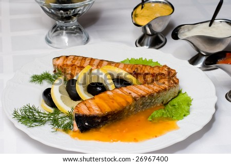 Grilled salmon fish with fresh, served up with different dressings