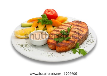 Grilled salmon fish with fresh vegetables on plate. Isolated on white.