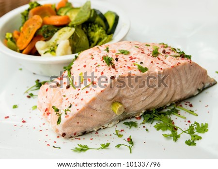 grilled salmon - french cuisine dish with tomato and salmon - stock photo