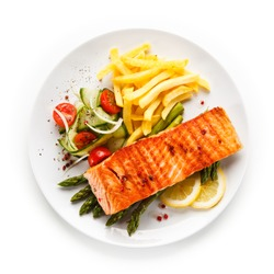 Grilled salmon, French fries and vegetables