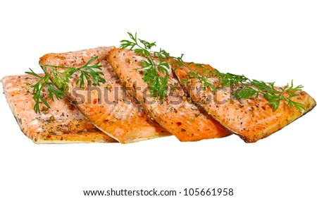Grilled salmon garnished with cilantro leaves