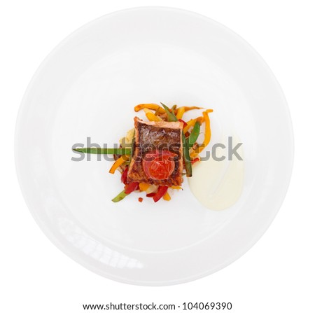 Grilled salmon on plate isolated on white background