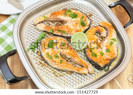 Grilled salmon steak. Three salmon steaks fried on grill pan. Viewed from above