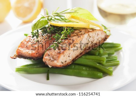 Grilled salmon steak with lemon and vegetables