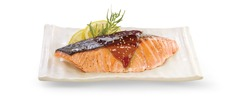 Grilled salmon teriyaki on white plate, isolated on whit background with clipping path.