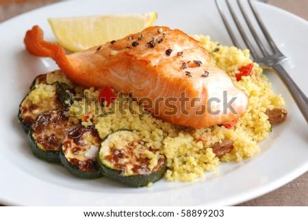 Grilled salmon with couscous and courgette