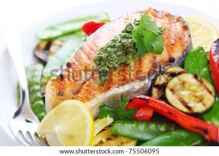 Grilled salmon with herb sauce