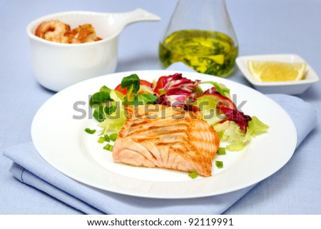 grilled salmon with mixed salad - stock photo