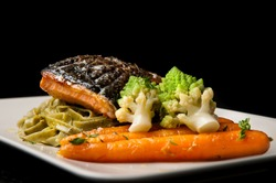 Grilled salmon with pasta, romanesco broccoli and glazed carrots