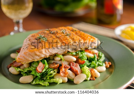 Grilled salmon with white beans, bacon, and kale