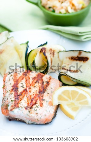 Grilled salmon with zucchcini skewers