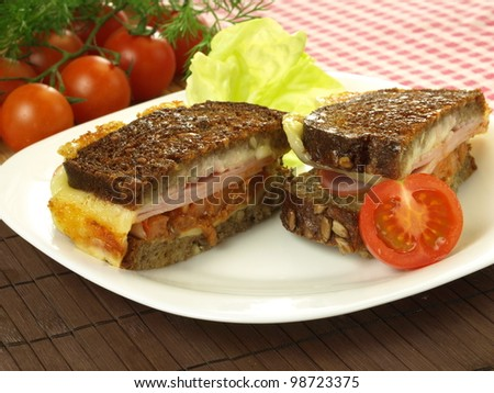 Grilled sandwich with cheese, ham and tomato