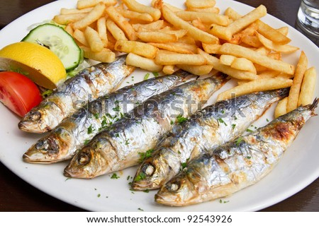 http://image.shutterstock.com/display_pic_with_logo/645541/645541,1326353092,2/stock-photo-grilled-sardine-fish-and-french-fries-served-on-a-plate-in-a-pub-92543926.jpg