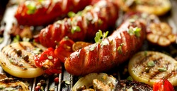 Grilled sausage and vegetables with fresh herbs