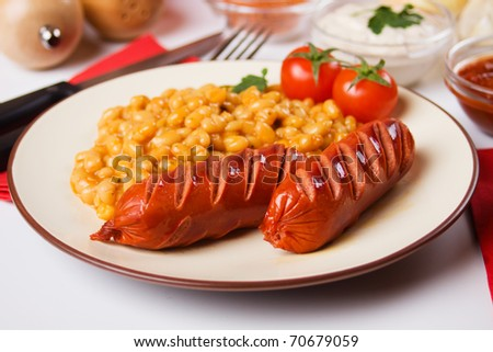 Grilled sausage and white beans, traditional european food