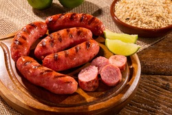 Grilled sausage. Grilled Sausage on wooden board. Brazilian barbecue.