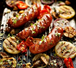 Grilled sausages and vegetables with addition spices and fresh herbs
