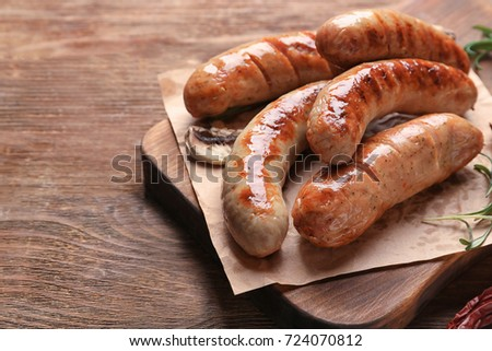 Grilled sausages on wooden board Сток-фото ©