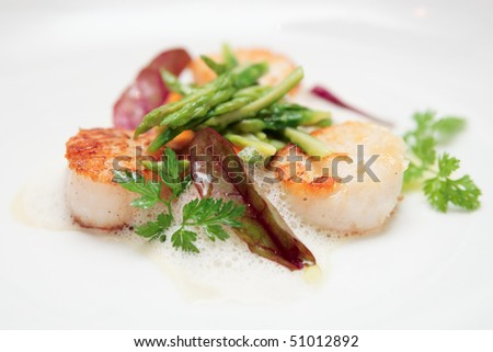 Grilled scallops with asparagus and molecular froth, closeup