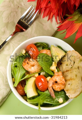 Grilled Shrimp salad with mache served with grilled bread