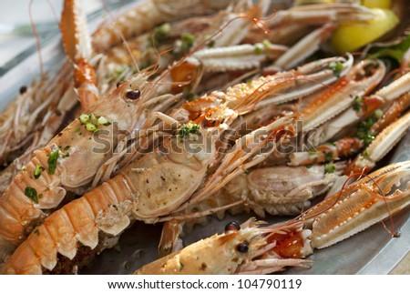 grilled shrimps on the serving plate, grilled shrimps