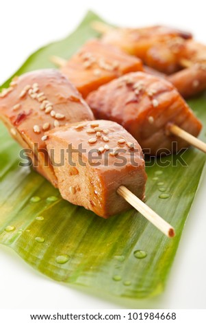 Grilled Shrimps, Salmon and Chicken Meat  Garnished on Green Banana Leaf