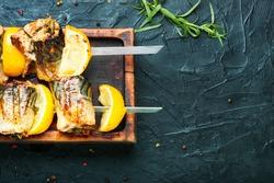 Grilled skewers of mackerel or scomber.Fish barbecue skewer