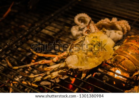 Grilled sliced lobster BBQ on grille. The picture refer to BBQ party.