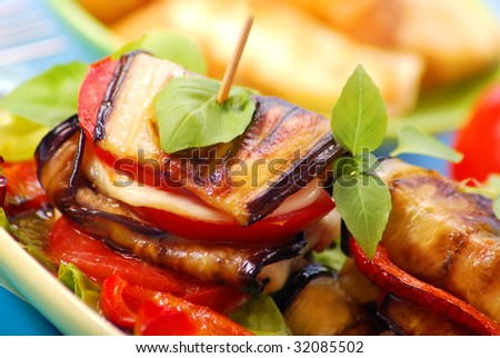 grilled slices of aubergine with cheese,paprika and tomato