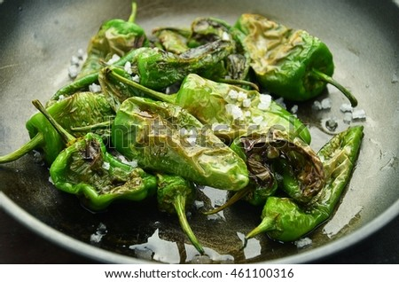 Shutterstock Grilled spanish green peppers with salt on frying pan