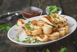 Grilled squid rings on a skewer
