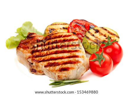 Grilled  steak and  vegetables isolated on white background