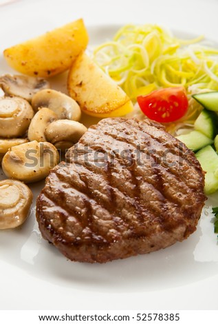 Grilled steak, chips and vegetables