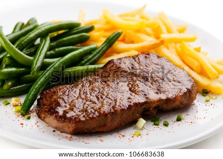 Grilled steak, French fries and green beans