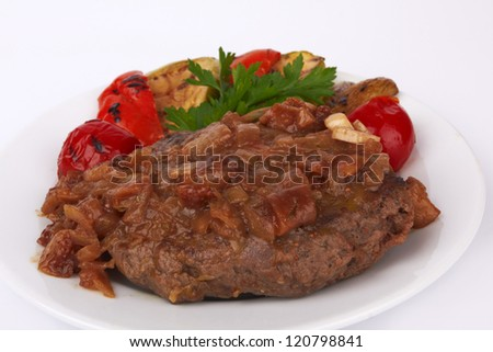 Grilled steak meat with vegetables on a white background
