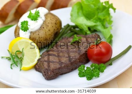 steak and baked potatoe