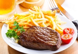 grilled steak with french fries