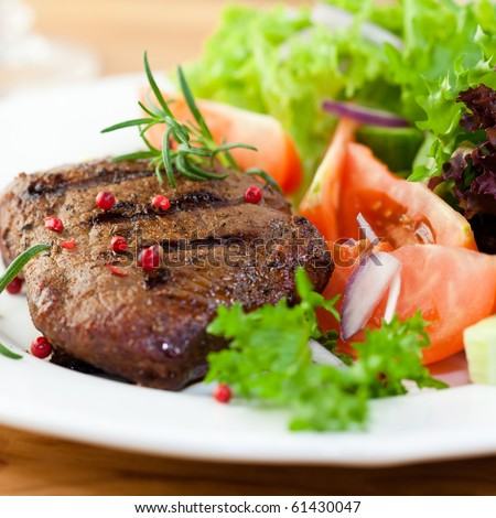 Grilled steak with fresh vegetables and herbs