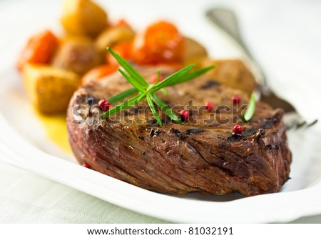 Grilled steak with roasted vegetables
