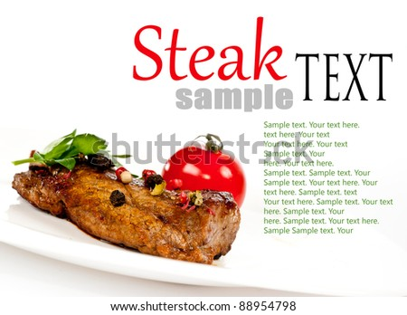 grilled steak with vegetables on a white