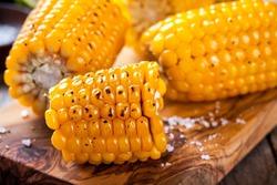Grilled sweet corn closeup on cutting board