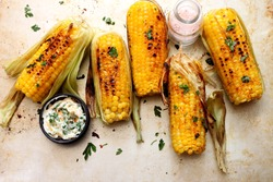 Grilled sweet corn with smoked paprika,  salt and cilantro.Summer vegan dinner or snack