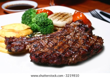 grilled t-bone steak and vegetables - stock photo