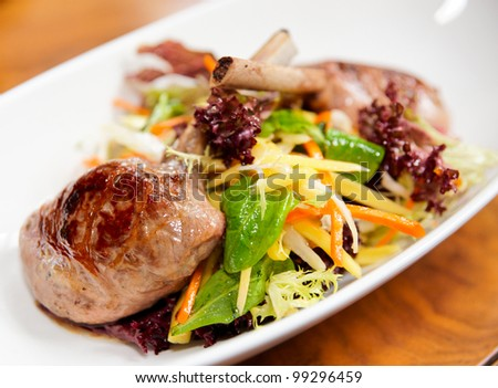 Grilled tack of lamb with salad, close-up