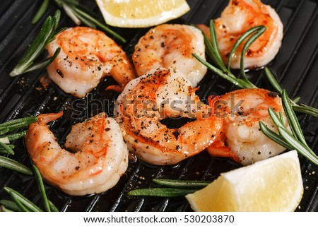Grilled tiger shrimps with spice and lemon. Grilled seafood.