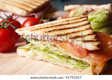 Grilled toast with ham cheese tomato and lettuce