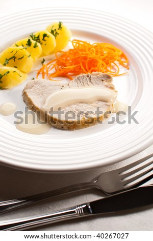 Grilled turkey fillet, boiled potatoes and vegetable salad
