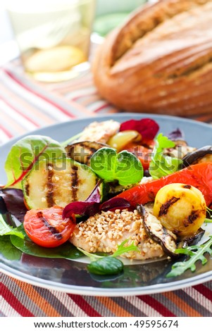 Grilled vegetables and chicken with sesame seeds
