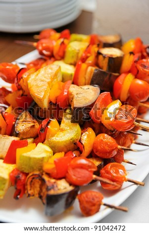 Grilled vegetables on skewers shot during catering event